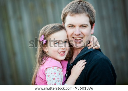 A portrait of a young Dad and his 5 year old daughter