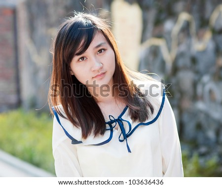 A portrait of a young female student on campus