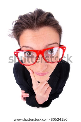 A portrait of a young frustrated woman in big red glasses over white background