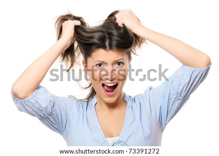 A portrait of a young frustrated woman pulling out hair over white background