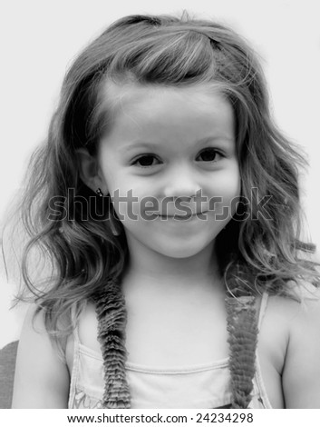 A portrait of a young girl with an adorable small smile on her face.
