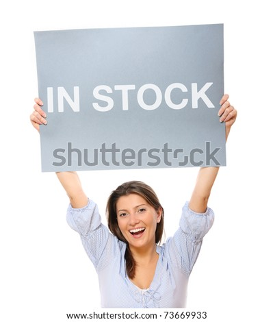 A portrait of a young happy woman holding a banner over white background