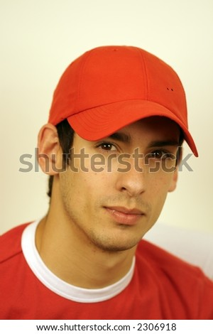 a portrait of a young man who looks friendly but serious