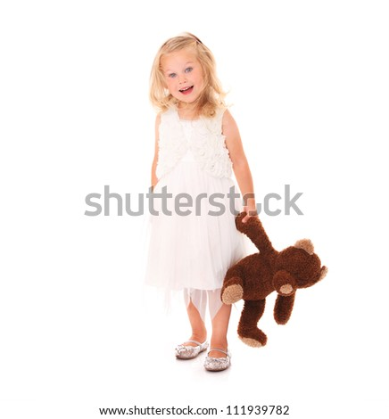A portrait of a young pretty with her teddy bear standing over white background