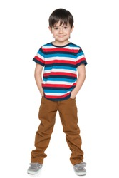 A portrait of a young smiling boy in striped shirt on the white background