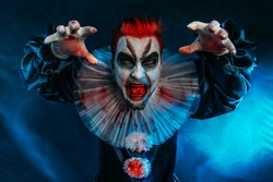 A portrait of an angry crazy clown from a horror film. Halloween, carnival.