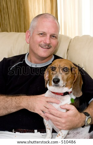 a portrait of an attractive man and his beagle dog