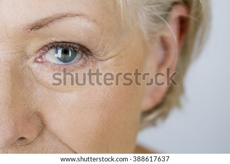 A portrait of an attractive senior woman, close-up of eye