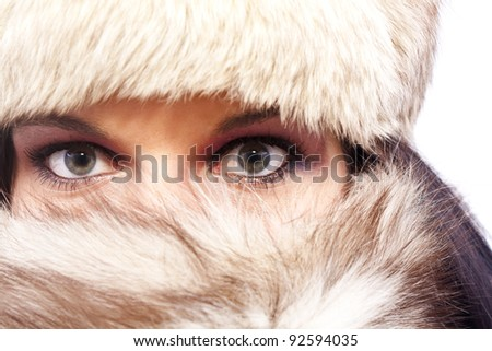 A portrait of an attractive woman wearing a fur hat - stock photo