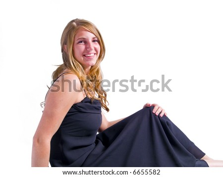 A portrait of an attractive young woman in a black dress isolated on a white background.