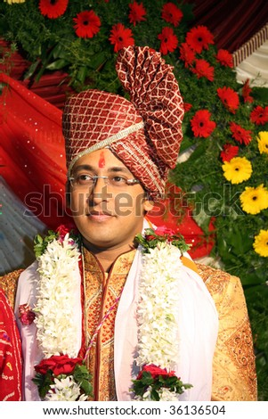 stock photo A portrait of an Indian groom in a traditional wedding attire