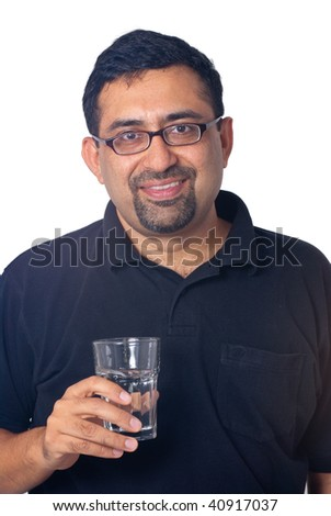 A portrait of an Indian man with a glass of water - isolated on white