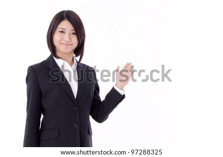 a portrait of asian businesswoman pointing isolated on white background