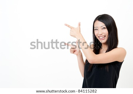 a portrait of attractive asian woman pointing