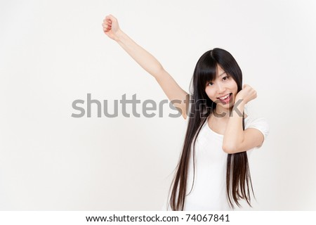 a portrait of beautiful asian woman cheering