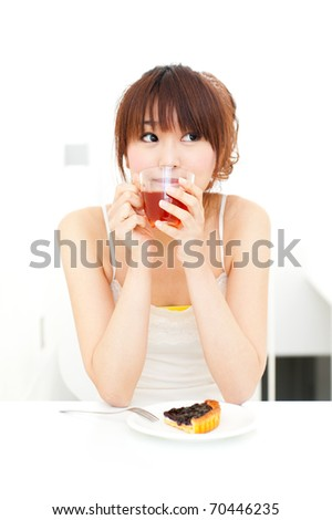 a portrait of beautiful asian woman drinking a tea
