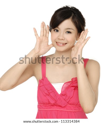 A portrait of beautiful young woman with hands near her face