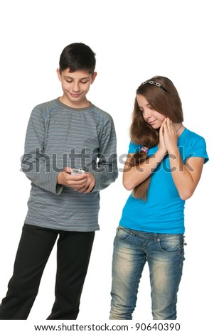 A portrait of fashion  teenagers with a cell phone; isolated on the white background