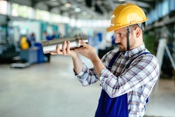 A portrait of handsome metal industry worker in factory