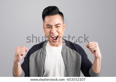 A portrait of happy excited young asian man with success positive emotions #653552107