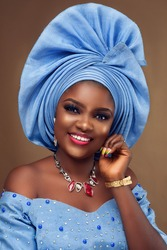 A portrait of pretty African young  lady wearing a native attire with gele