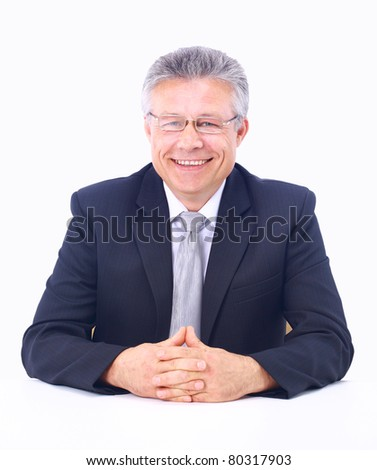 A portrait of senior businessman sitting during an interview isolated against white background