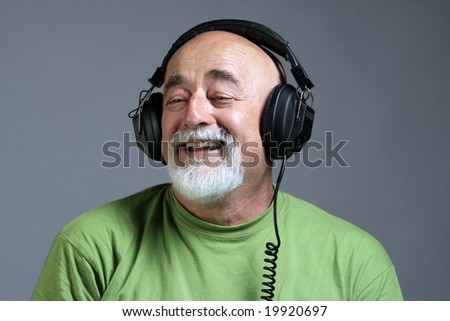 a portrait of smile old man with head phones