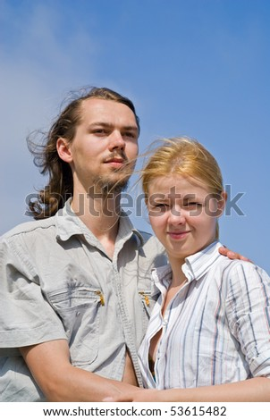 A portrait of the young man and woman on nature. Summer, sunny day.