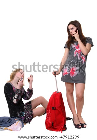 A portrait of two young pretty girls with a big red bag