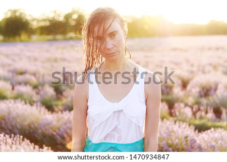 A portrait of young caucasian beautiful sad wet girl, with wet dress and wet hair
