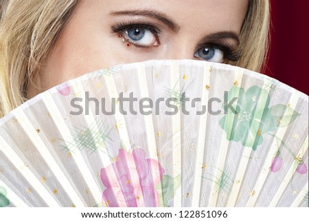 A portrait of young lady with a fan