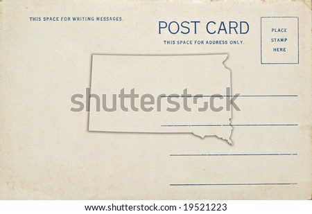 A postcard with a South Dakota map outline. Dirt and scratches at 100%.