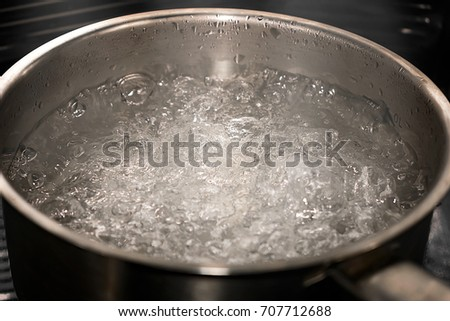 A Pot of Boiling Water with Steam