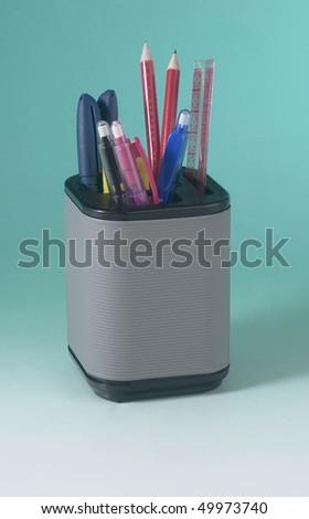 A pot of pen and pencils.