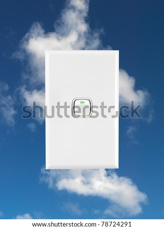 A power button isolated against a blue sky