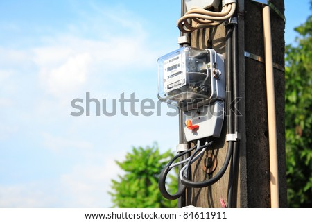 A power meter on electrical pole