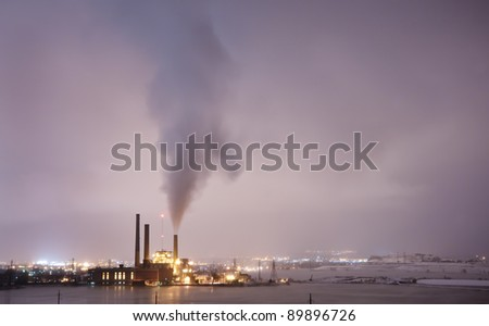A power plant spreads pollution over the city of Boulder, Colorado