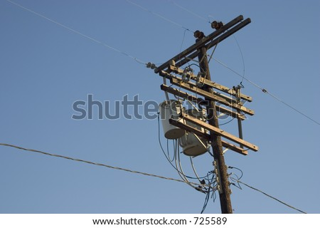A power pole with all its do-dads against the sky.