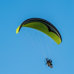 A powered paraglider flying Powered paraglider (