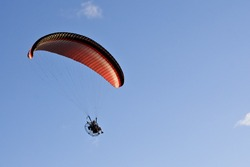 A powered paraglider in flight. Paragliding is also known as paramotoring.