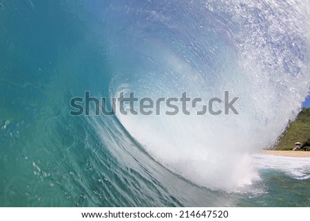 a powerful wave breaks along the shore. #214647520