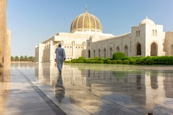 A prayer on his way to the Muscat Grand Mosque in the typical Omani dress early in the morning - 4