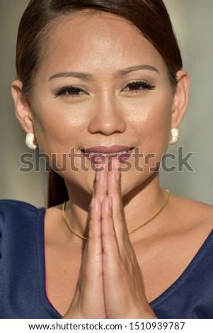 A Praying and Youthful Female #1510939787