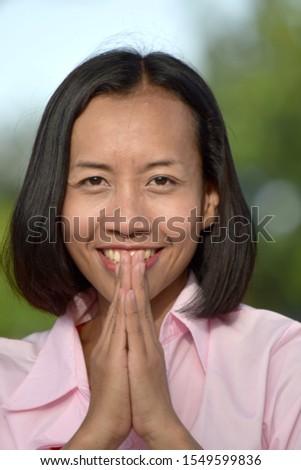 A Praying Attractive Filipina Female