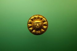 A Pre-Columbian golden face from Colombia