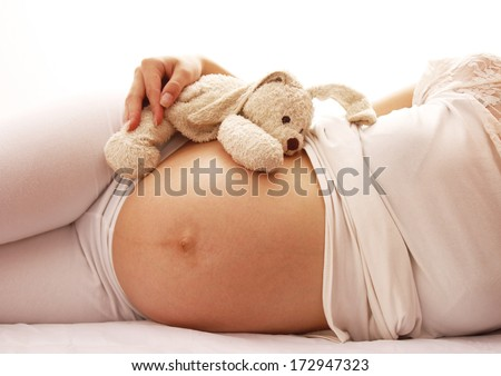 Shutterstock a pregnant woman on a white background