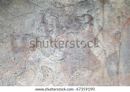 A prehistoric cave painting in Bhimbetka -India , a world heritage site which shows a faded out painting.