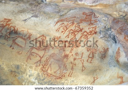 A prehistoric cave painting in Bhimbetka -India , a world heritage site which shows a war scene.