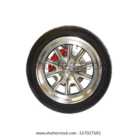 A premium racing tire on a high end magnesium wheel isolated on white
