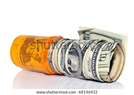 A prescription pill bottle with rolls of cash in it.  Concept or metaphor for cost of drugs.